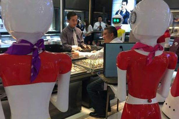 Robot maids help wealthy Chinese shopper